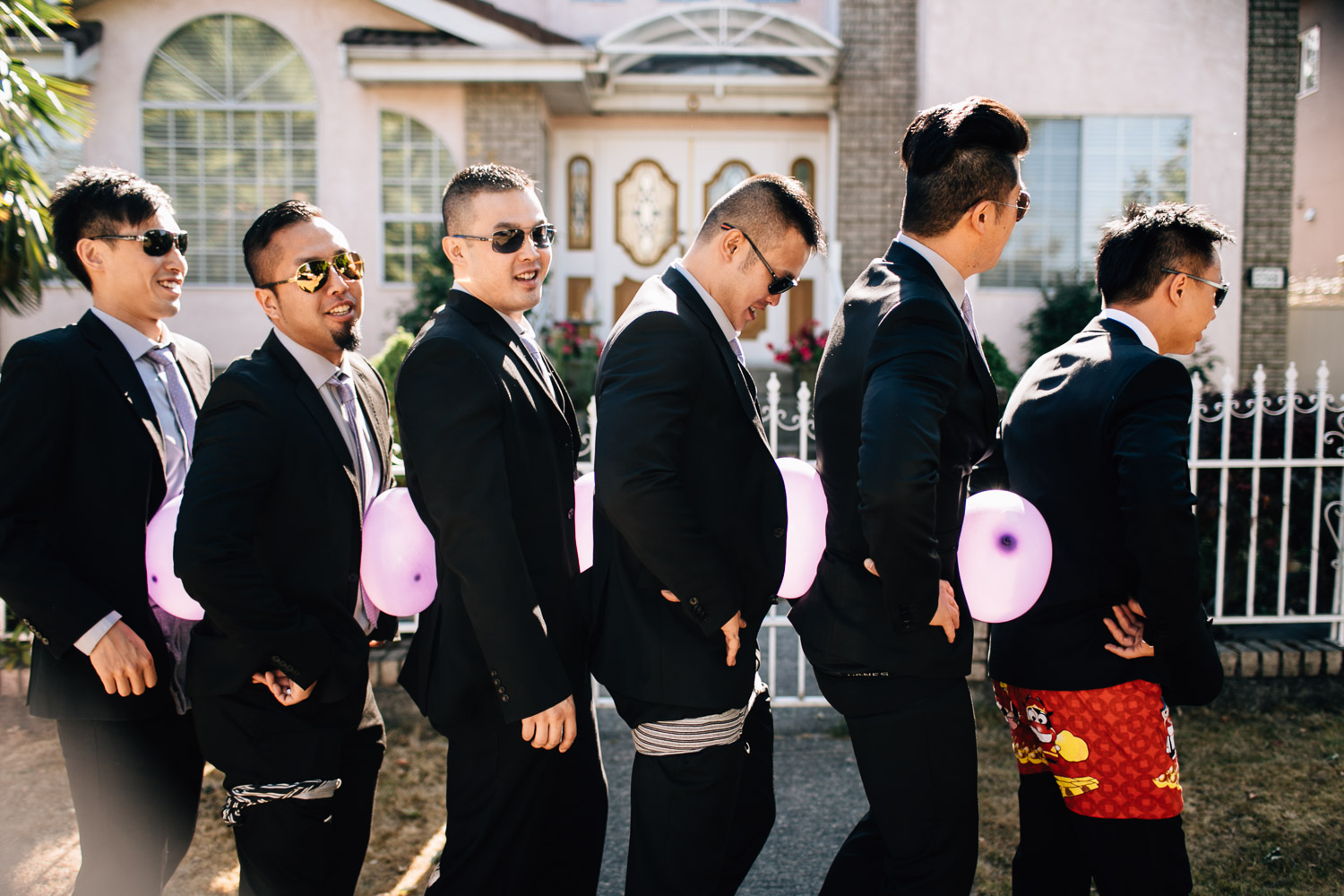 groomsmen chinese door games candid vancouver wedding photographer