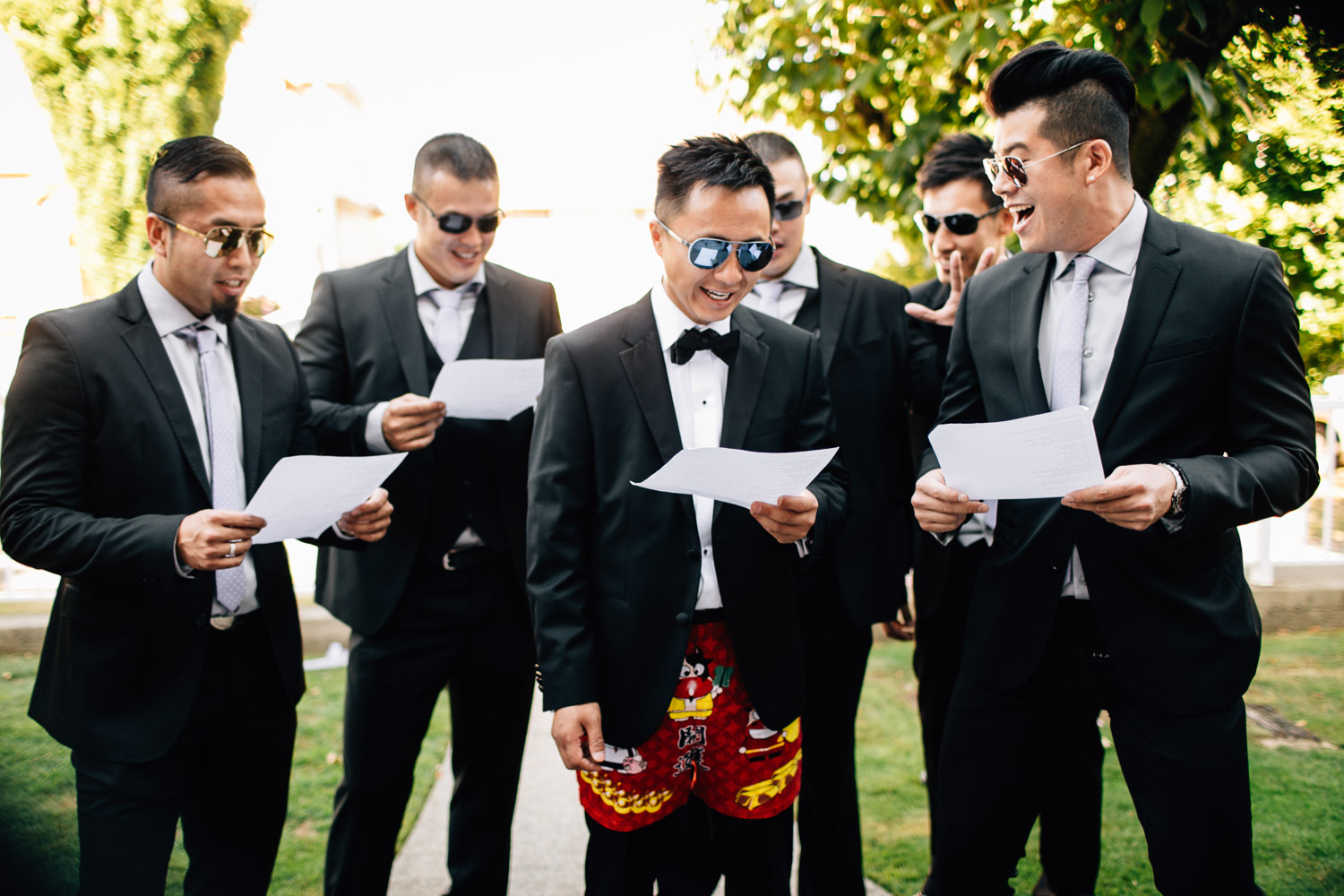 chinese door games vancouver wedding photography groom and groomsmen singing