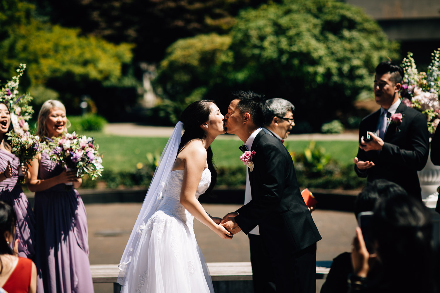 wedding kiss at alter ubc sage bistro ceremony
