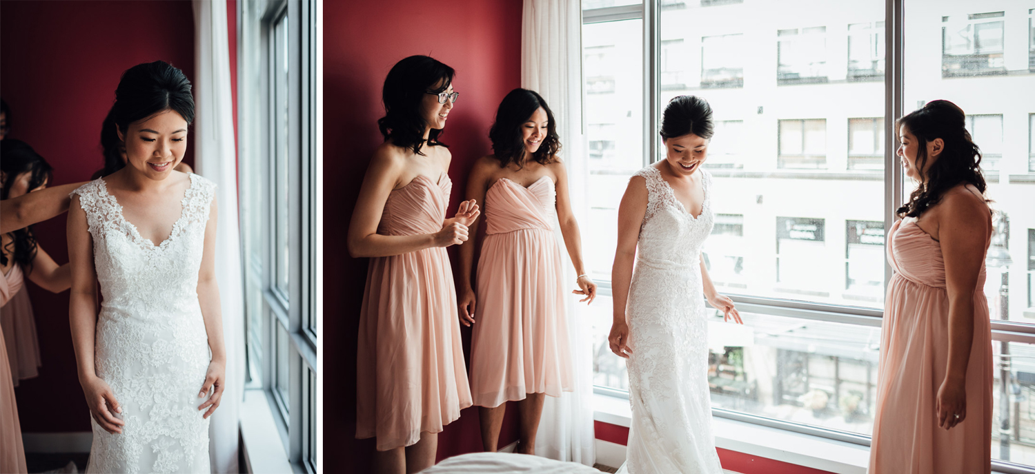 bridesmaids help buttoning up bride's dress in opus hotel yaletown vancouver bc wedding