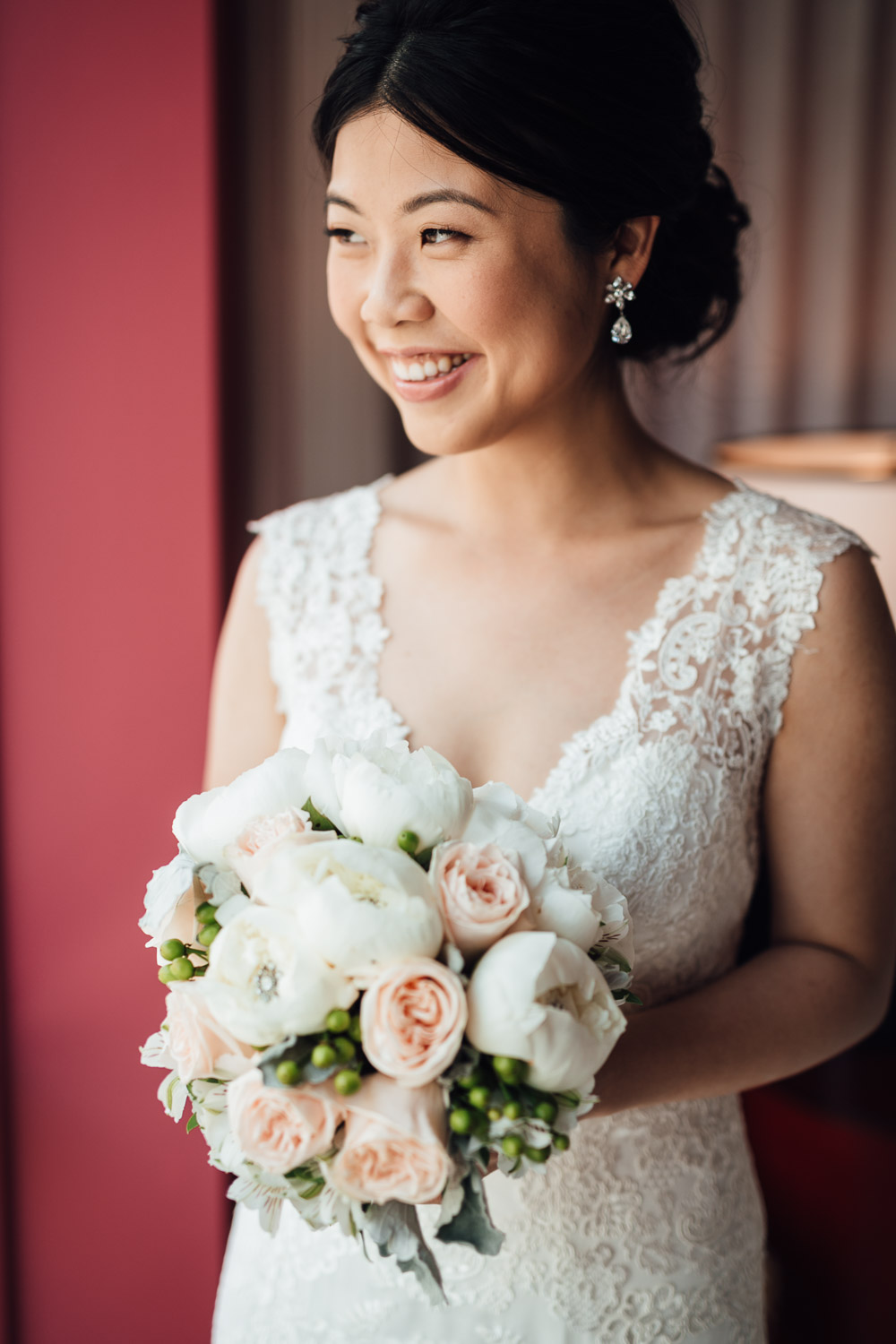 bride looking out window with bouquet vancouer wedding photography