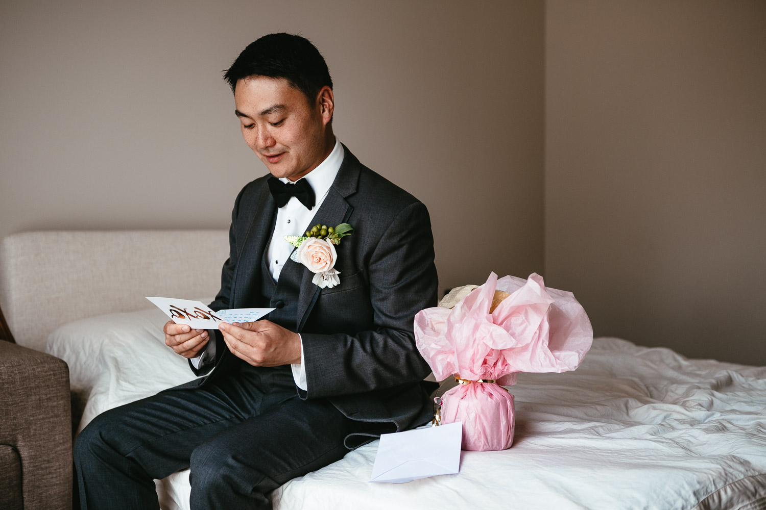 groom reading card from bride vancouver wedding photographer
