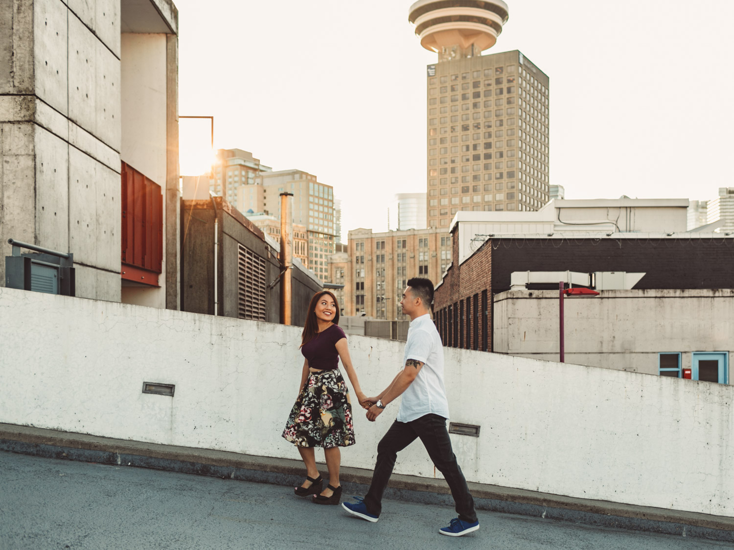 engagement photographer in vancouver at gastown during sunset on rooftop