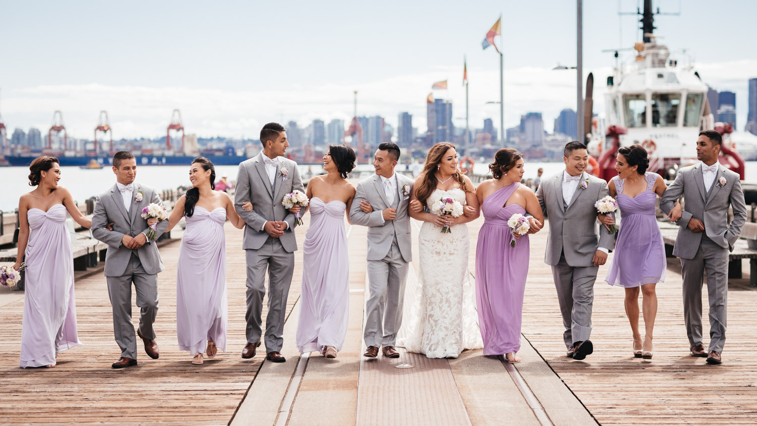 bridal party candid at burrard dry dock in North Vancouver BC wedding