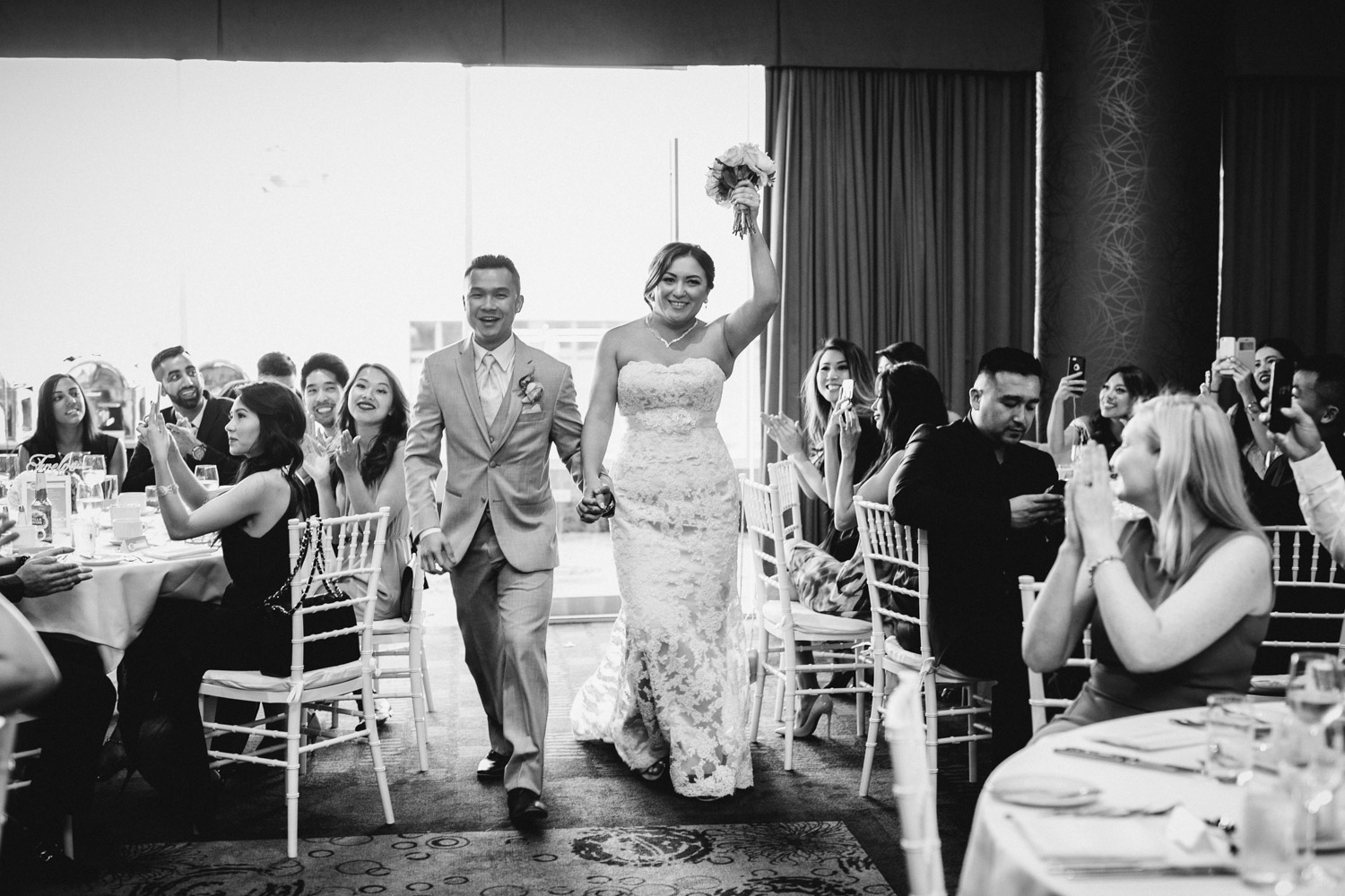 bride and groom reception entrance at pinnacle at the pier in north vancouver wedding photography