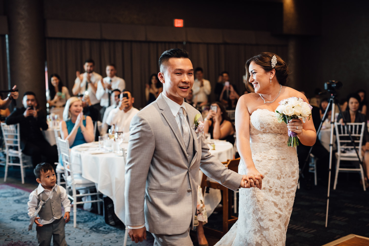 bride and groom reception entrance at pinnacle by the pier in north vancouver wedding photography