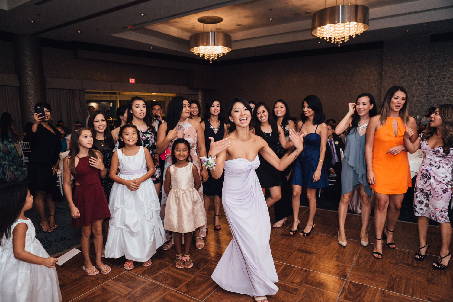bouquet toss wedding reception photography in north vancouver pinnacle at the pier amie nguyen