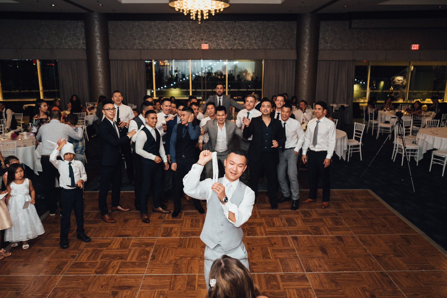 garter toss groom wedding reception at pinnacle at the pier in north vancouver photography