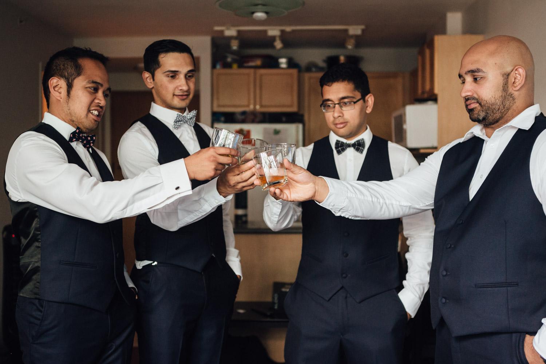 vancouver wedding photography groom cheers wiskey