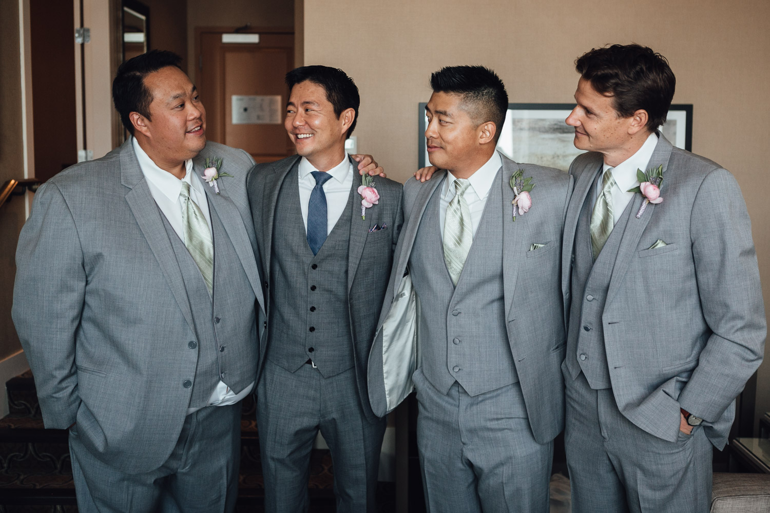groomsmen and groom candid at river rock casino in richmond bc wedding photography