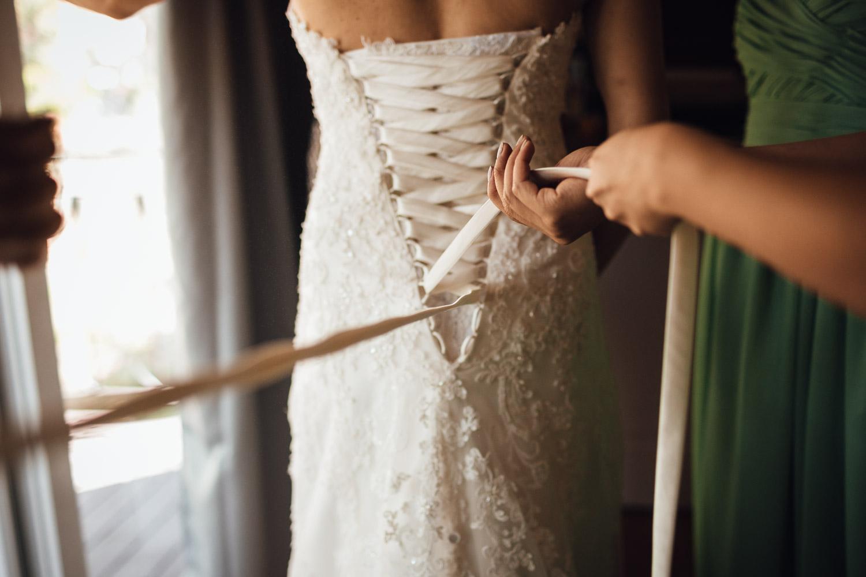 tying wedding dress vancouver wedding photography vancouver bc