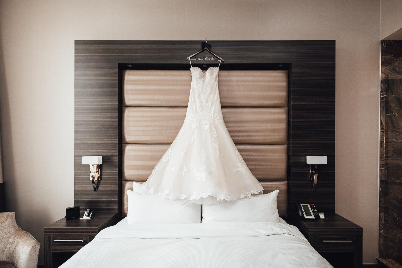 wedding dress in burnaby delta hotel photography