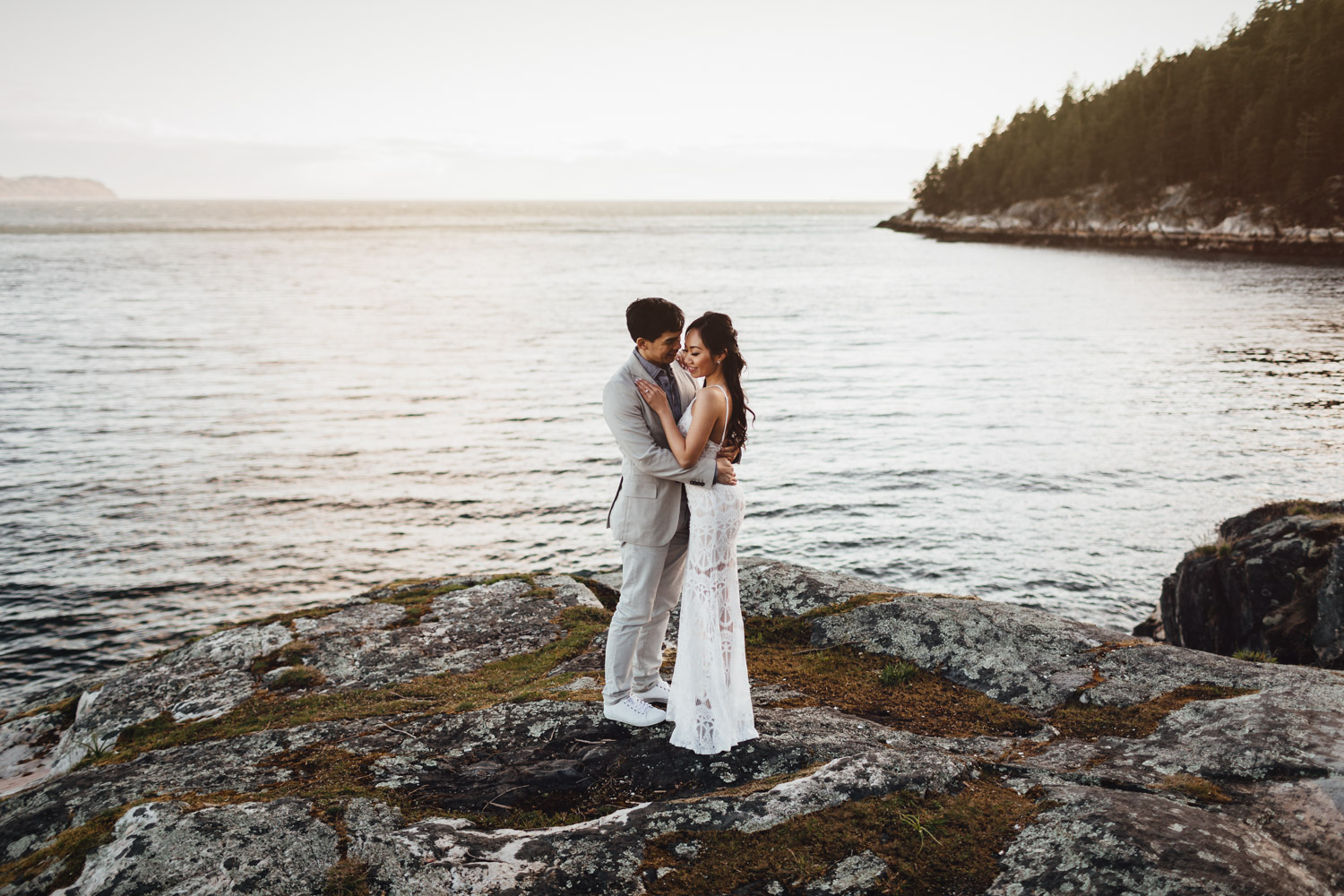west vancouver engagement photography rocks water and sunset during golden hour