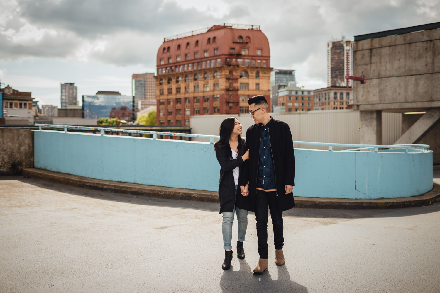 gastown candid walking rooftop parkade engagement photography in vancouver bc