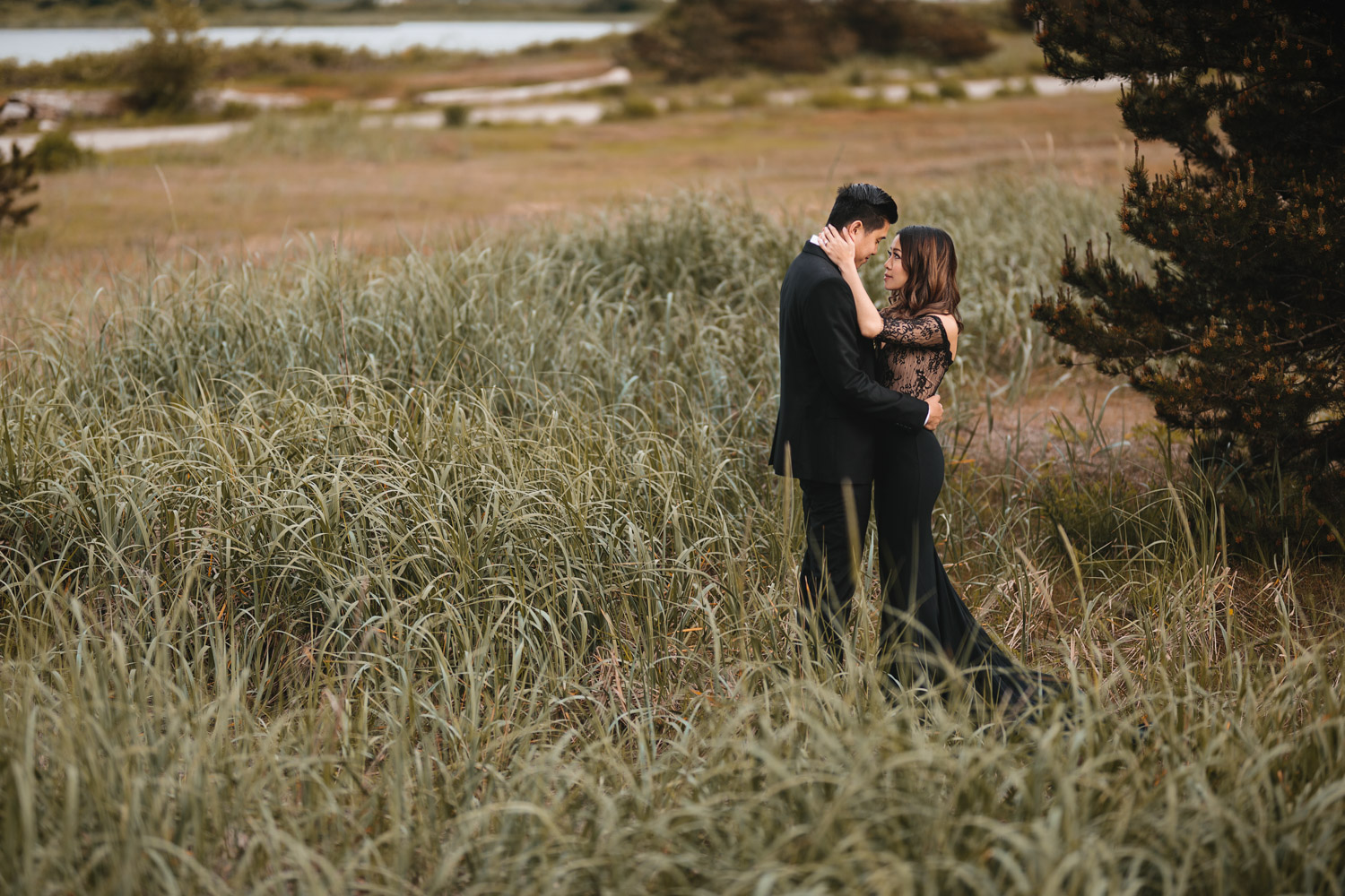 engagement photography in field at wild park iona beach in richmond bc