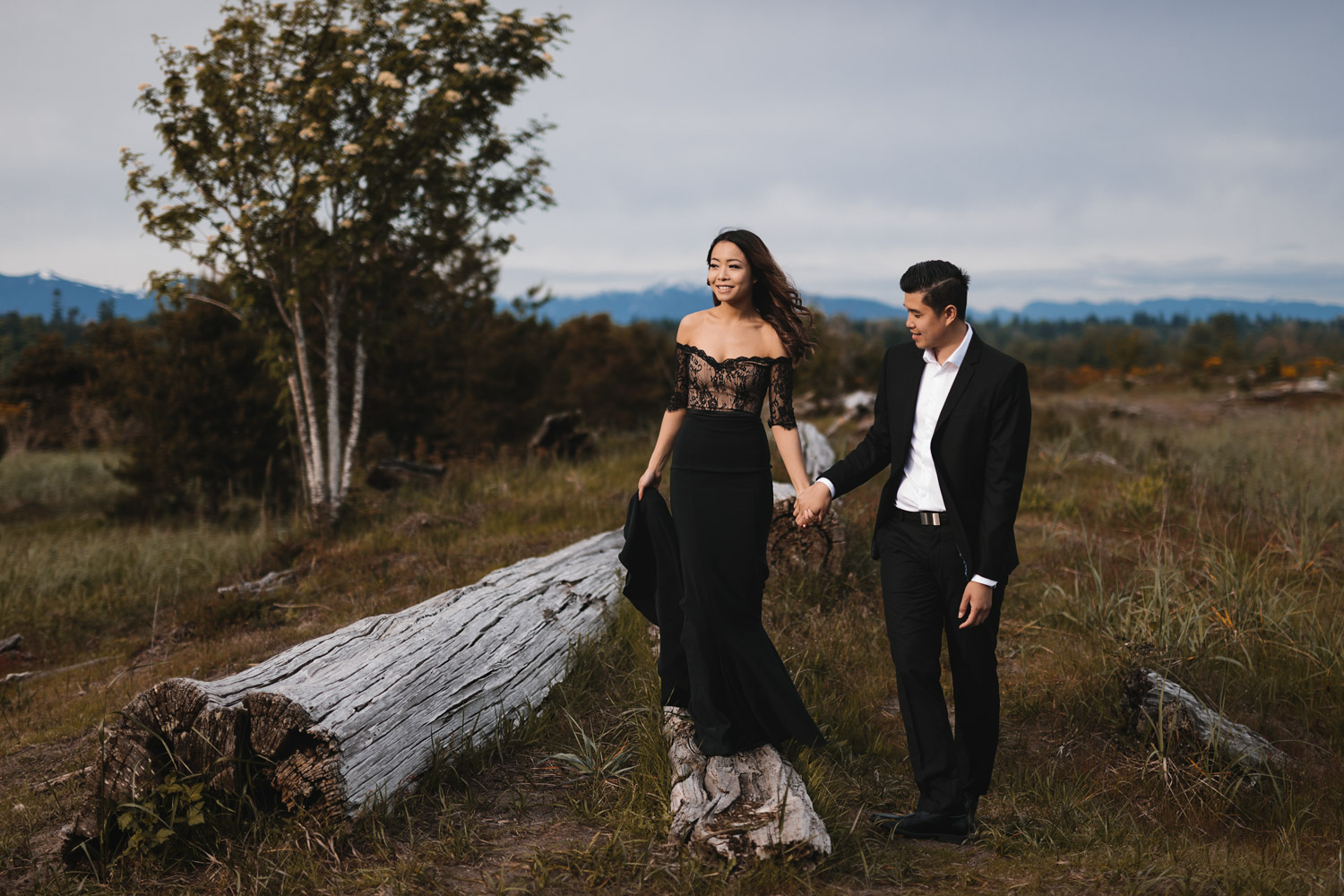 windy engagement photography during sunset at iona beach in richmond bc