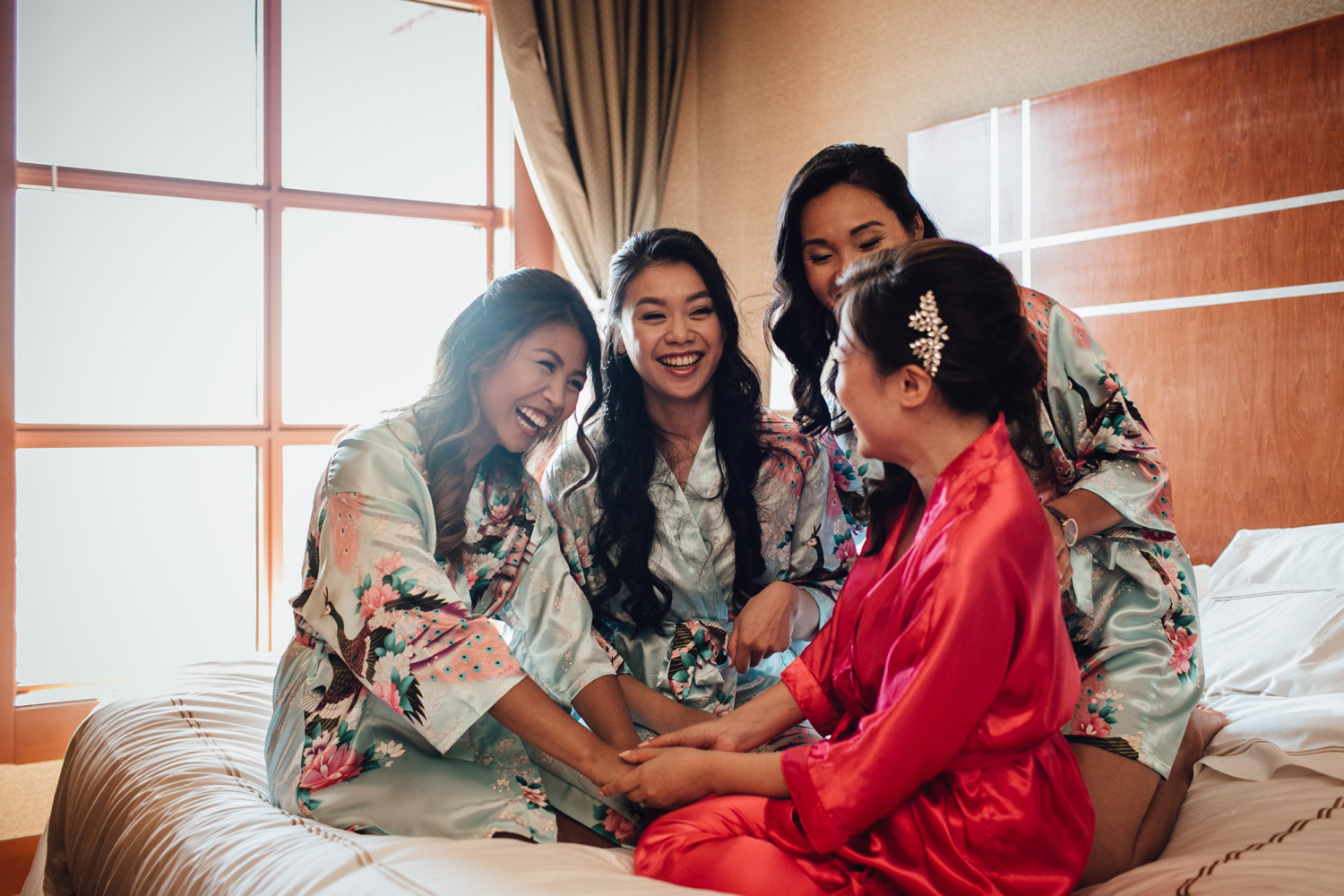 bride and bridesmaids river rock casino hotel bed candid wedding photography