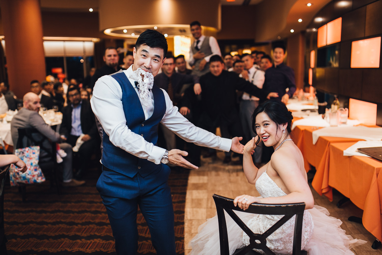 garter toss chinese wedding reception photography at kirin restaurant in new westminster