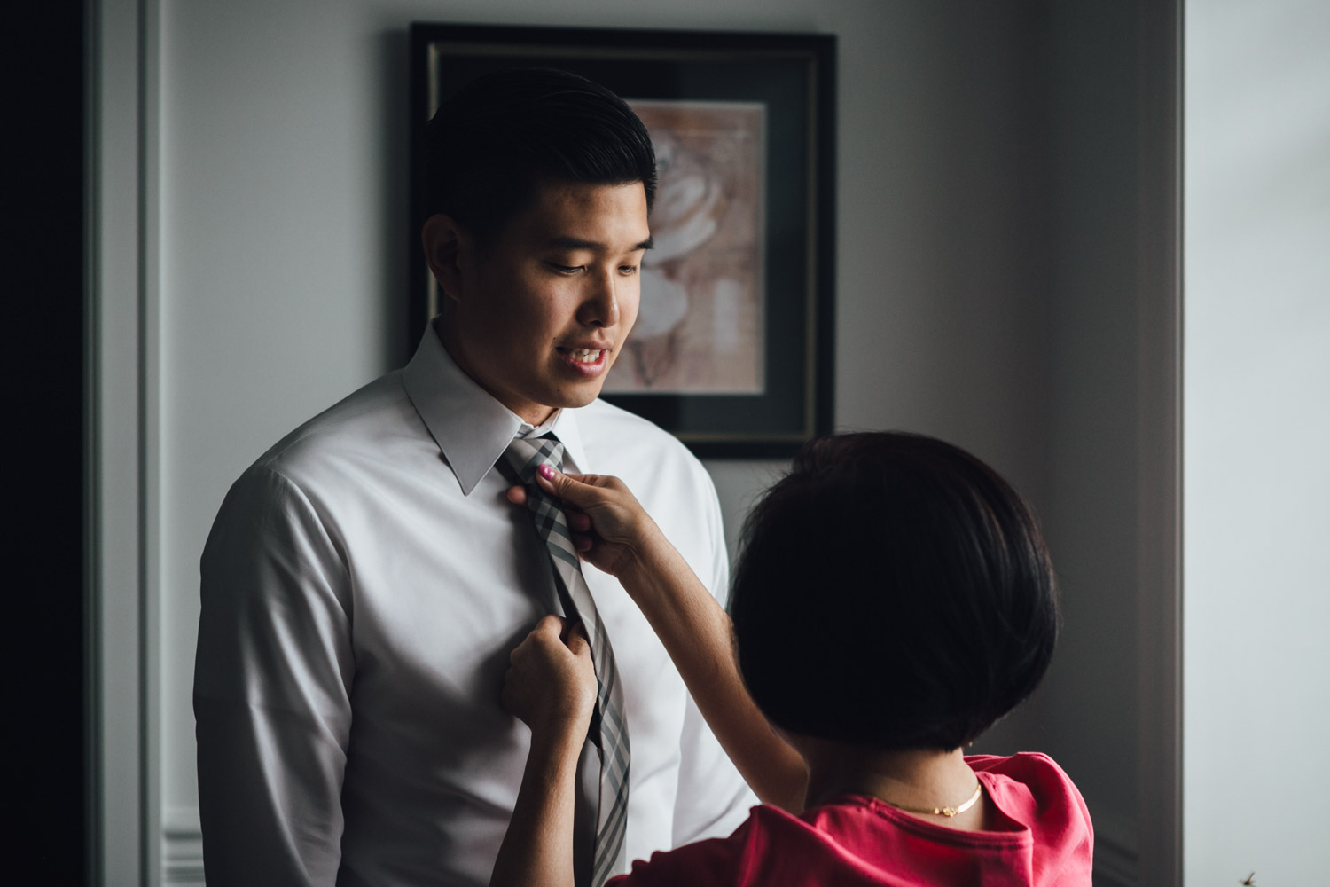 groom getting ready for wedding photography in vancouver bc