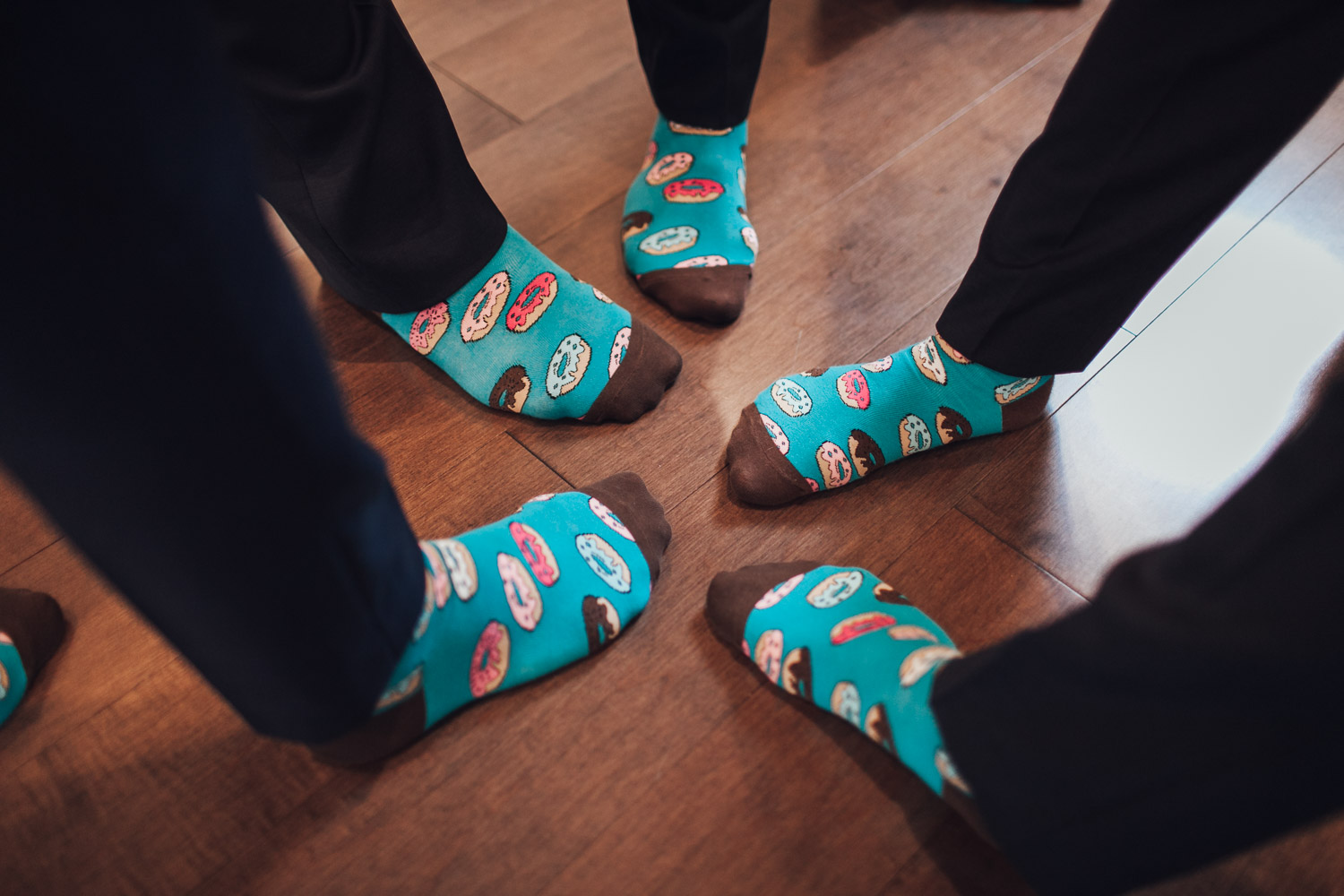 groom donut socks vancouver getting ready wedding photography