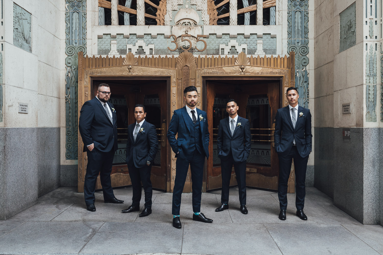 marine building groomsmen portrait vancouver wedding photography
