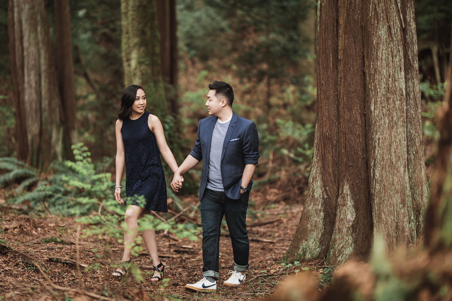 vancouver engagement photographer in stanley park during spring cherry blossom season