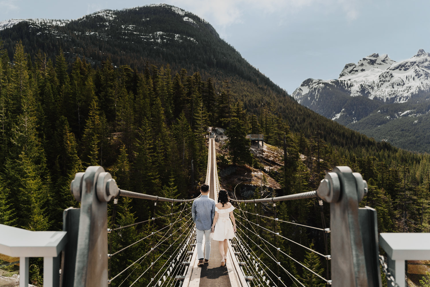 sea to sky gondola engagement photography suspension bridge during spring
