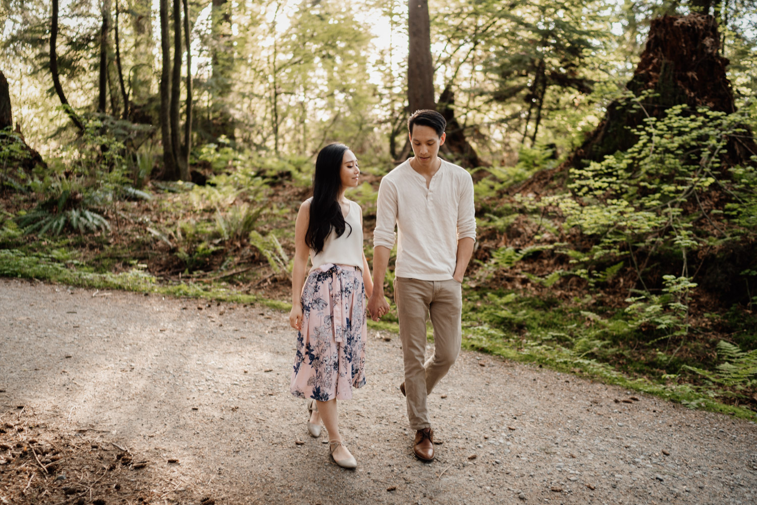 walking candid in stanely park forest engagement photography vancouver bc