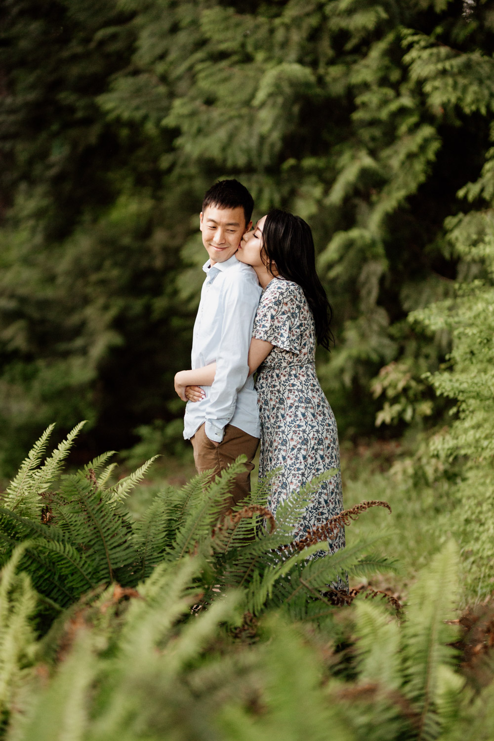stanley park engagement photography in vancouver bc during sunset or golden hour at rose garden