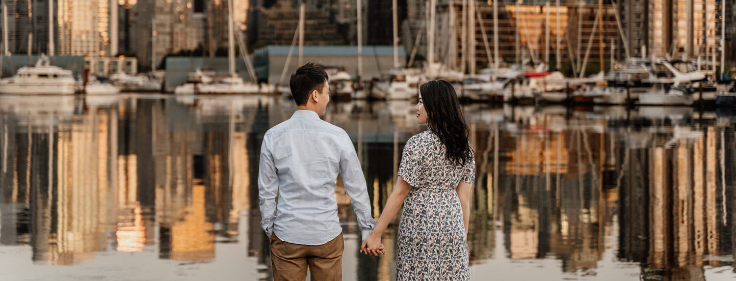 stanley park engagement photography in vancouver bc during sunset or golden hour skyline view