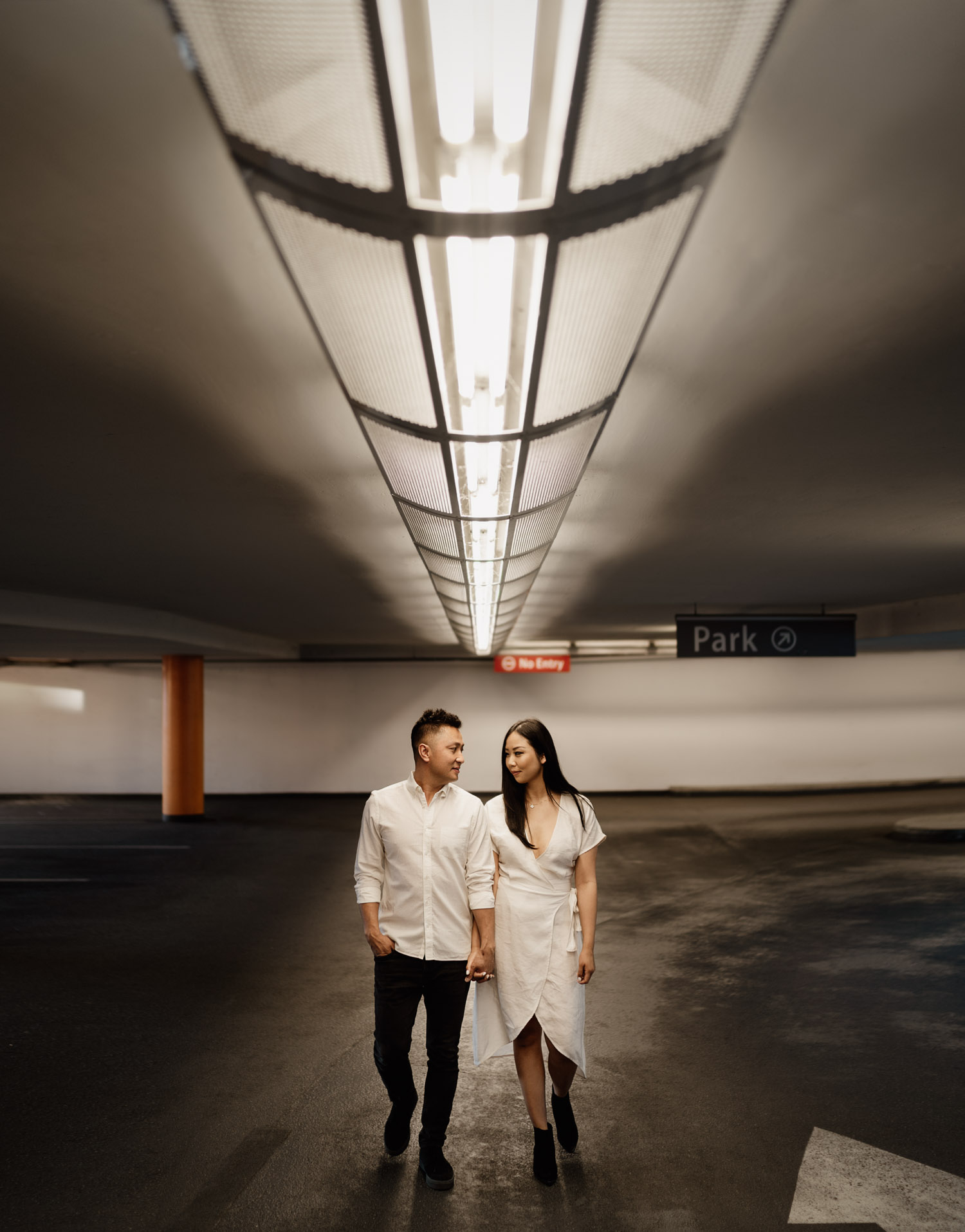 gastown parkade engagement photography during golden hour in the summer located in vancouver bc canada