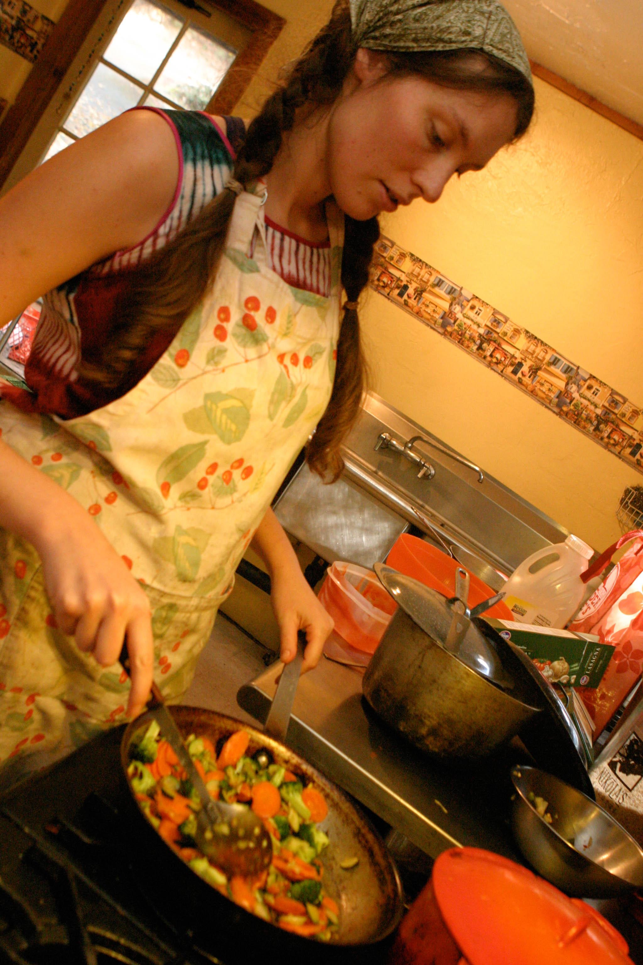 Renee making dinner for everyone