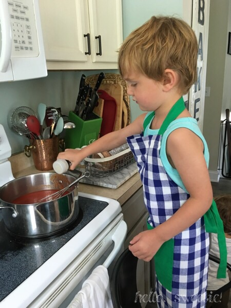 our four year old, learning the tradition of making the family sauce! (Love that crazy post-nap hair!)