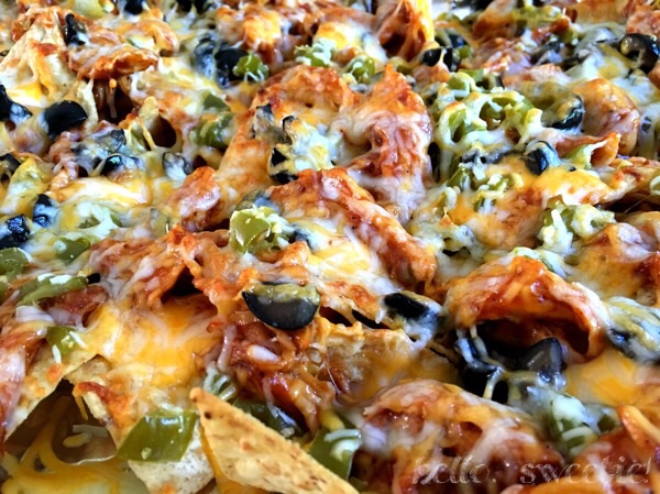 Cheesy smothered BBQ chicken nachos