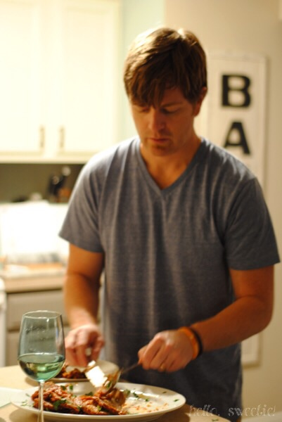 I relax with wine and grab the camera while Matt slices & plates it up.
