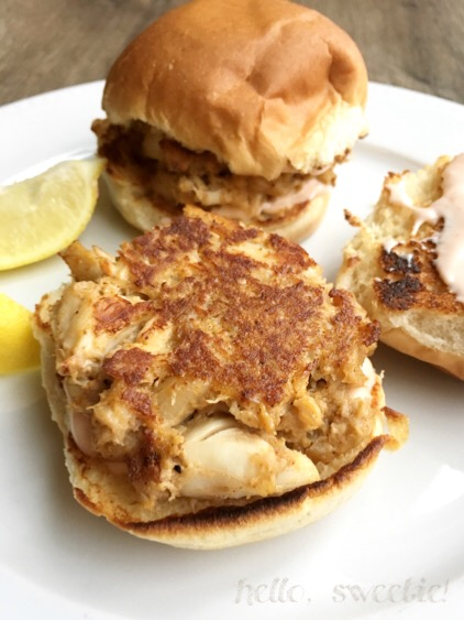 Squeeze fresh lemon juice on the crab cakes & serve on toasted slider bun with spicy aoili.