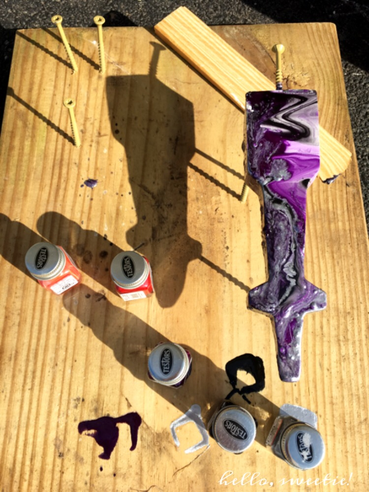 Building a little tripod stand helps the cars to dry without smudging or damaging the paint.