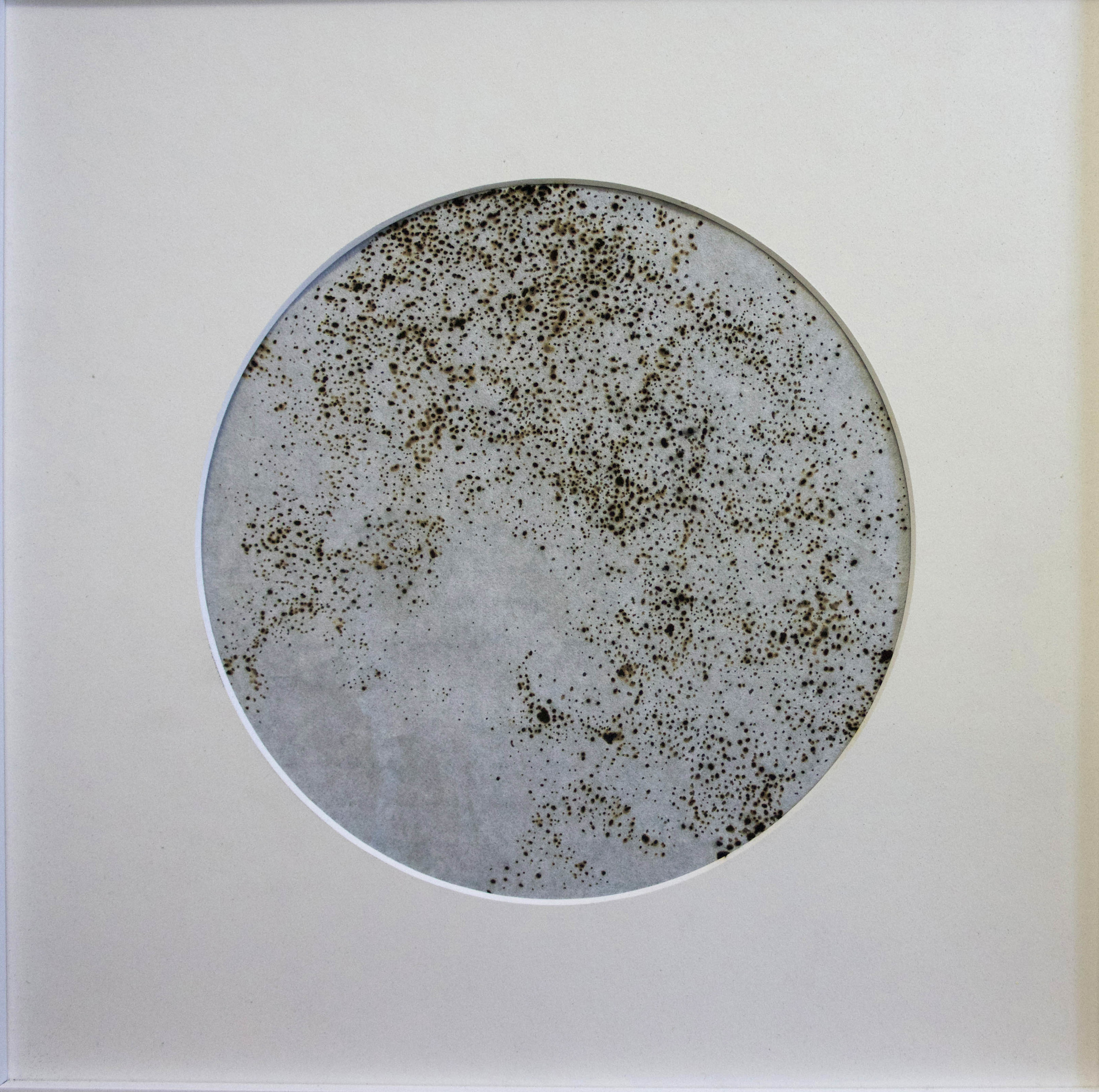'Moon 1', burnt pricks into rice paper with black backing, 30 x 30 cm