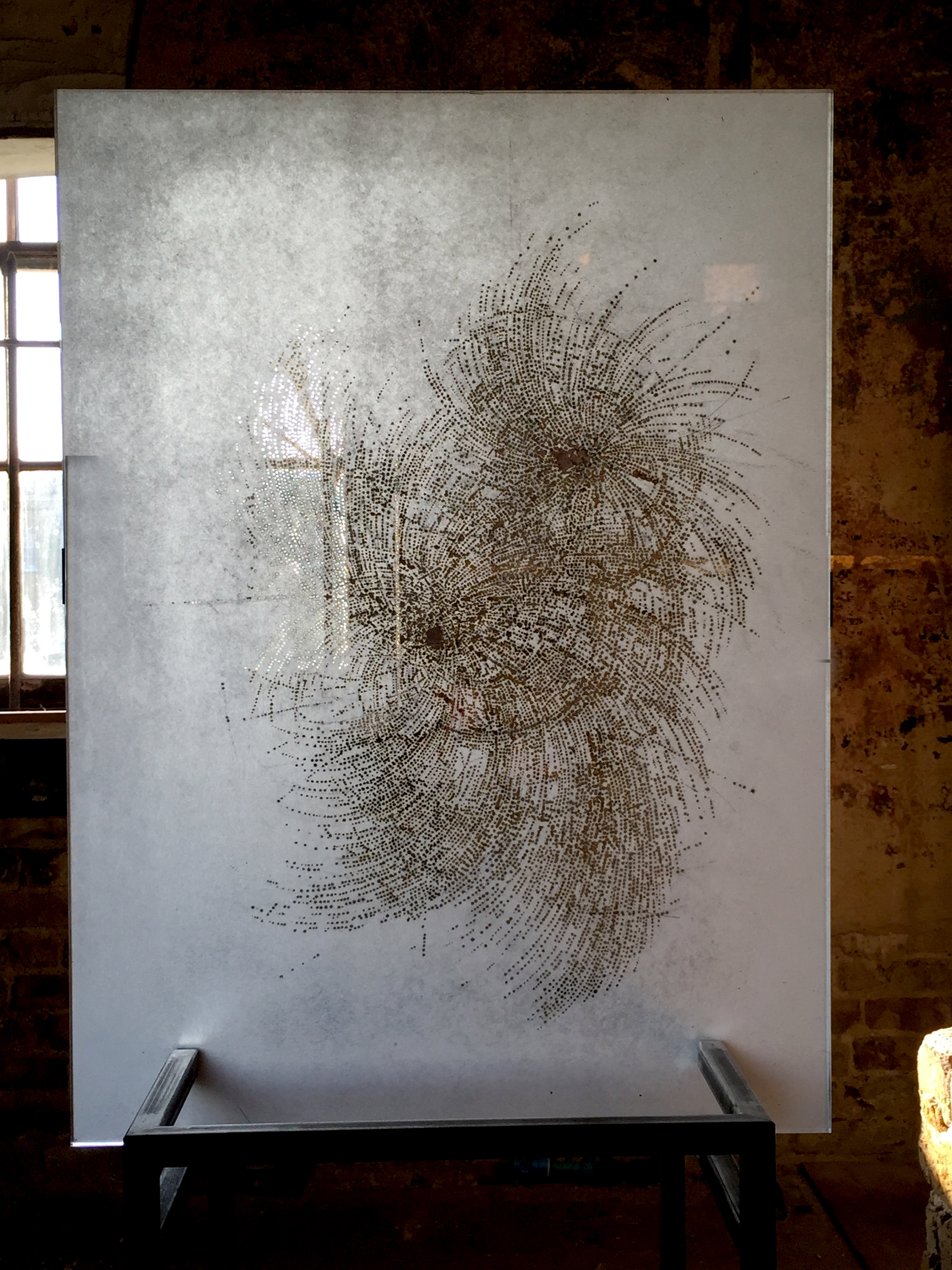 'Whorl' , incense burnt rice paper, in perspex on steel plinth, 75 x 55 cm