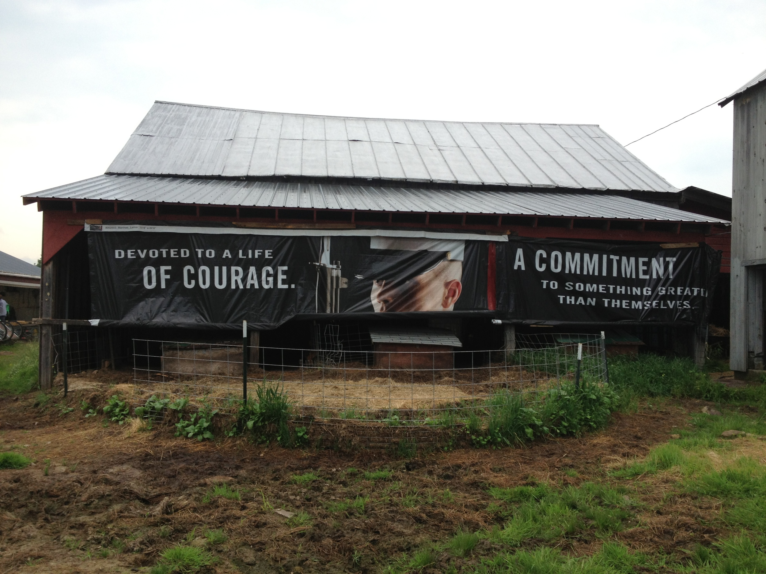 Another great example of creative recycling - a vinyl Marines banner provides some extra cover on an open-sided barn.