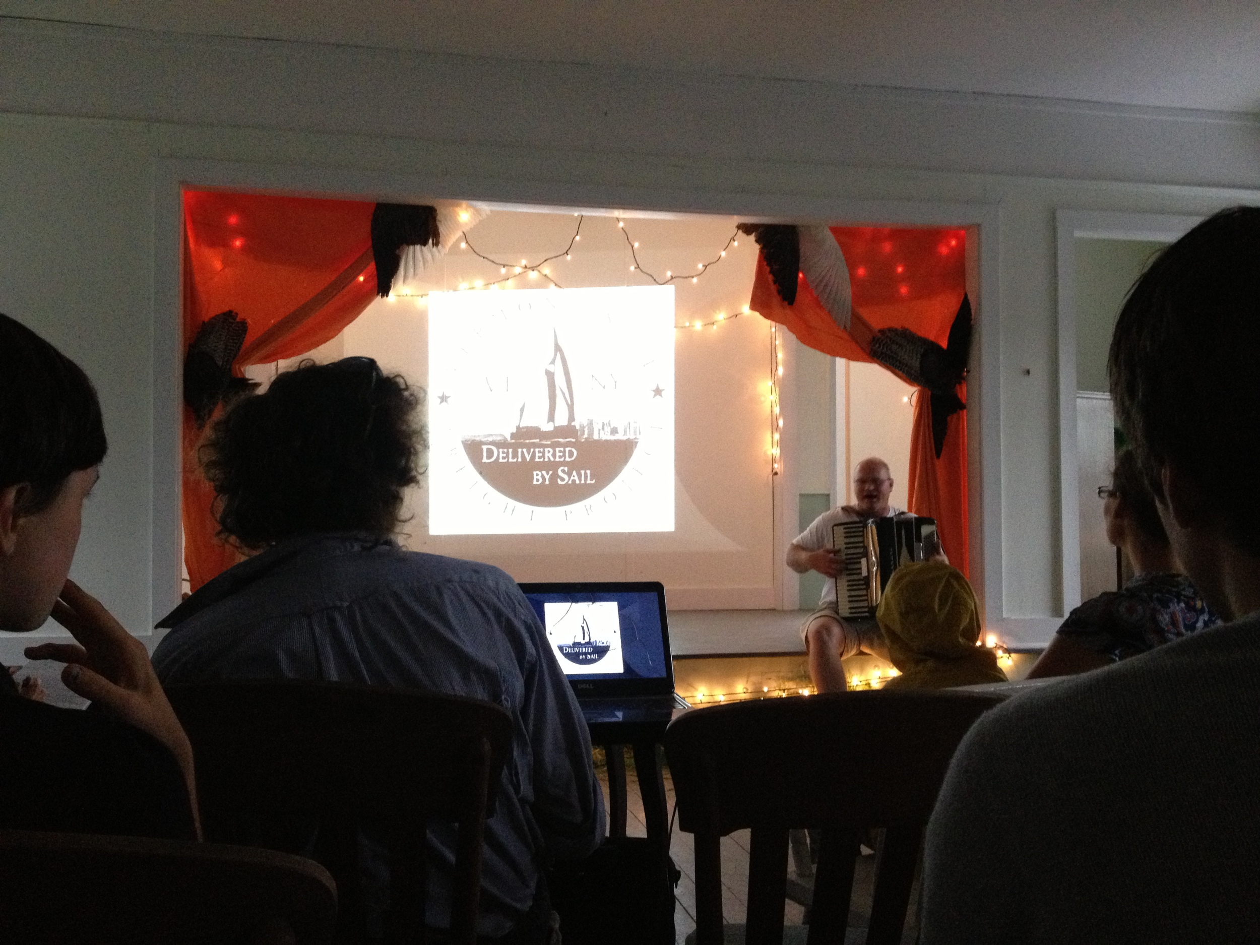Back at the Ausable Grange, we heard a talk from Eric Andrus (seated with accordion), founder of the  Vermont Sail Freight Project . His vision is to have a fleet farmer-owned sail-powered barges moving goods from farms up around Lake Champlain down the Hudson to markets in New York City. He's currently finishing construction on the first barge, which will launch in July and have its maiden voyage in September. Each barge can be manned by two people, will carry about 10 tons (including pallets), and will take about ten days each way.