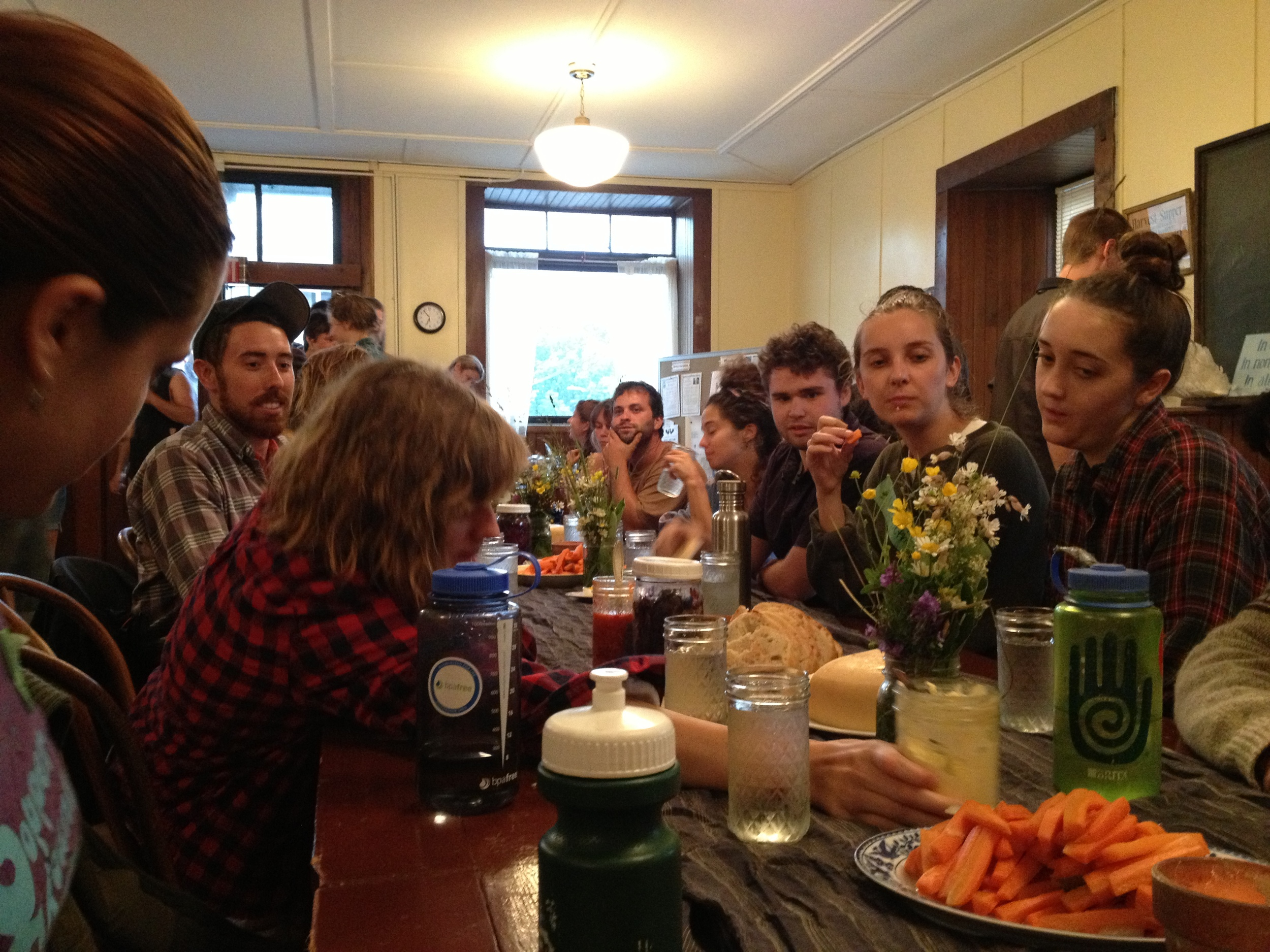 Back downstairs, we gathered for a solstice feast, with food grown by some of the farmers in attendance.