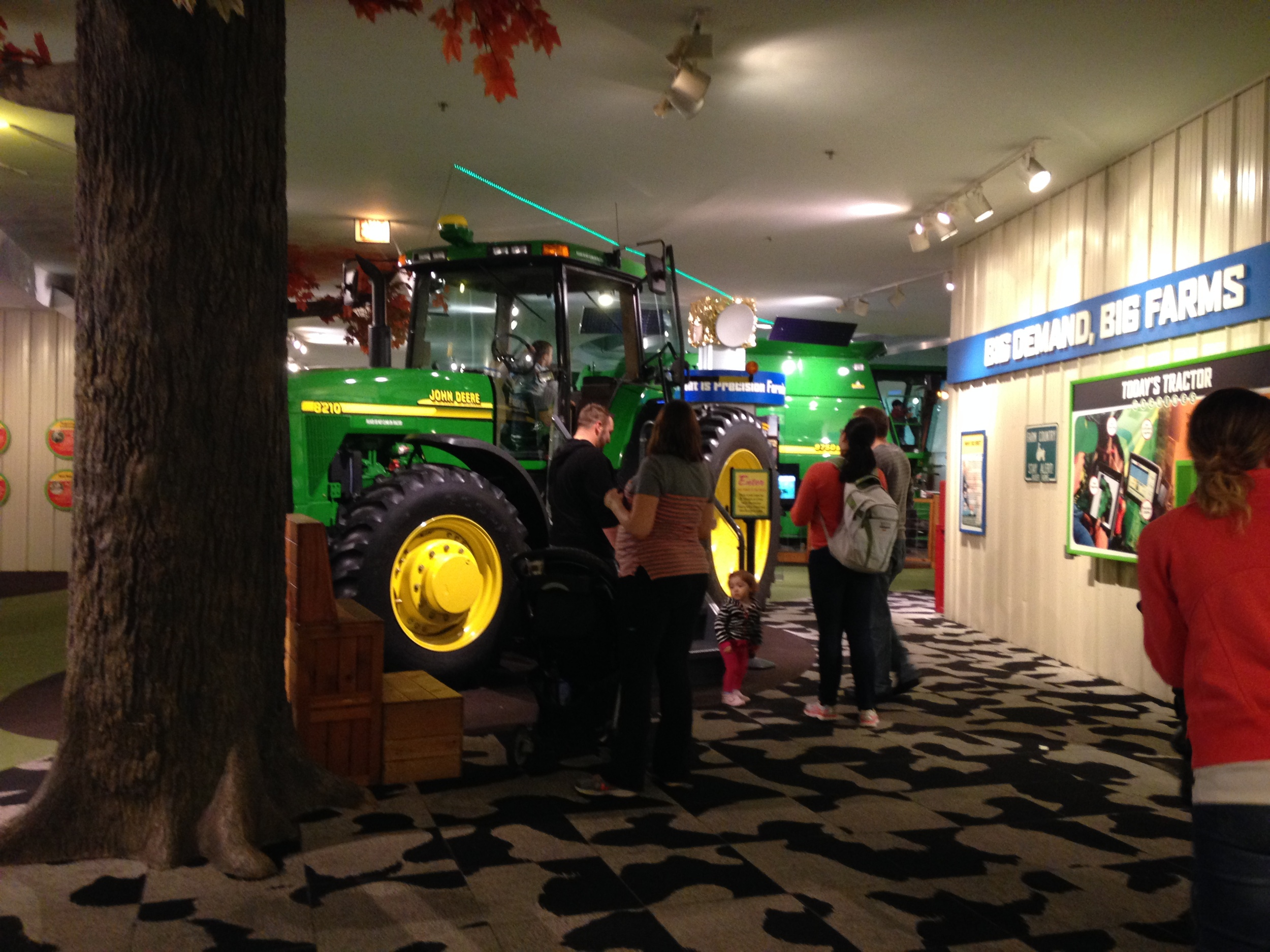 Families check out a John Deere tractor