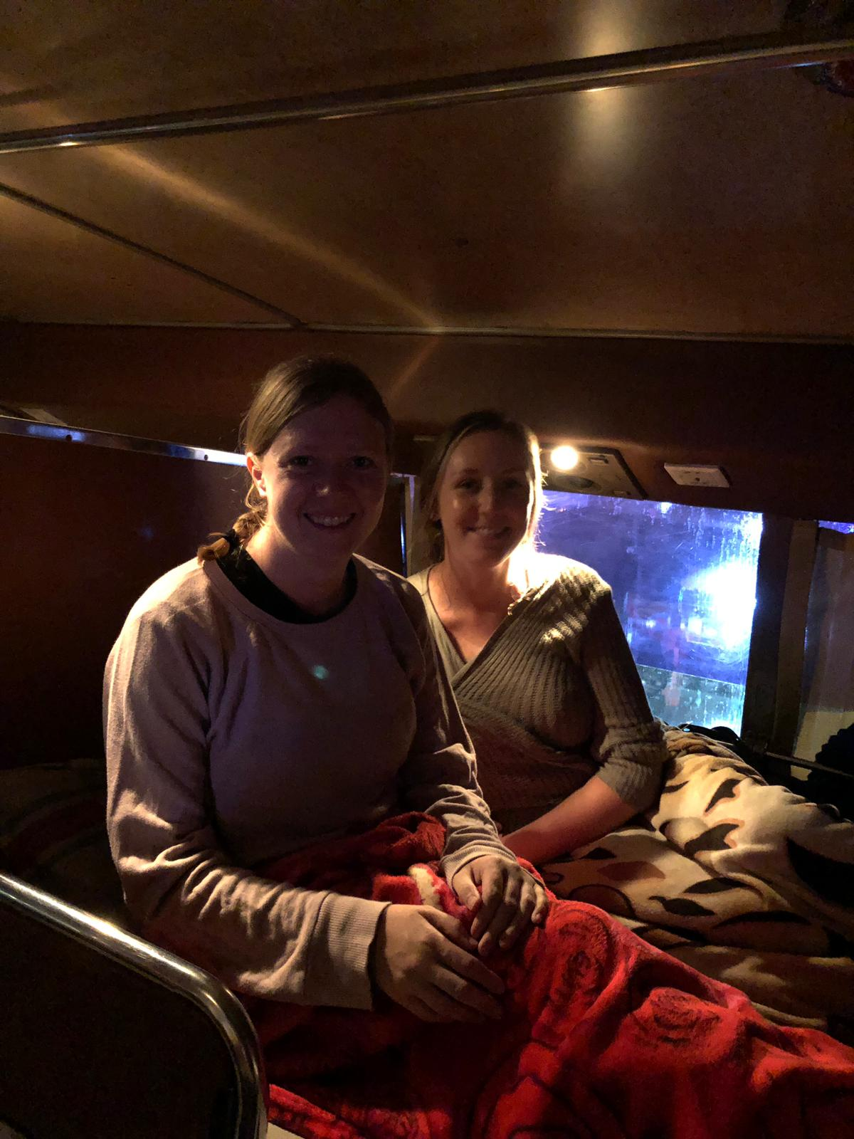 My friend Helen and I with ample room on our very first sleeper bus! This was a fun and hilarious experience to share.