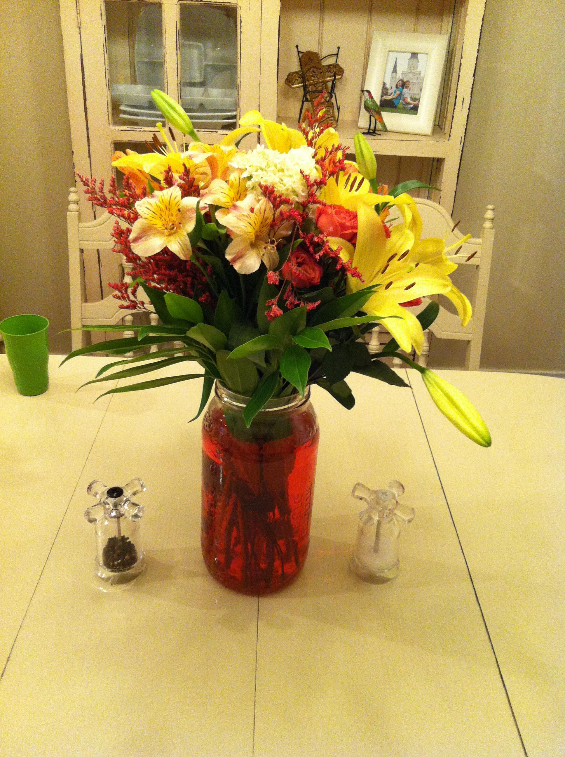Vlasic pickle jar flower vase - excuse the green cup!