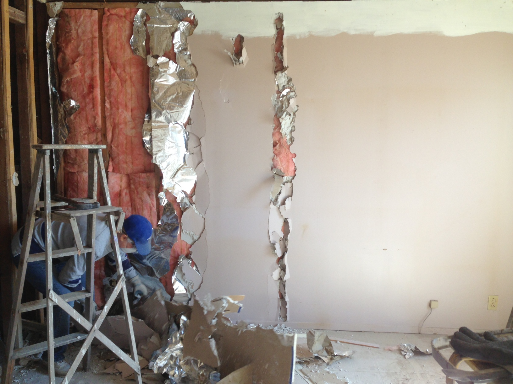 Taking down drywall in first room