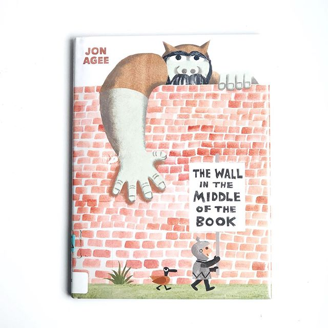 "Overdue Library Book of the Week: ""The Wall in the Middle of the Book"" by #JonAgee for #Dialbooks. A book about preconceived assumptions. A book about unfounded fear. A book about keeping the wrong things out. A book about a wall....hmm. A brilliant and subtle take in a time where even kids can see what's right and wrong. Get it!! #overduelibrarybookoftheweek"