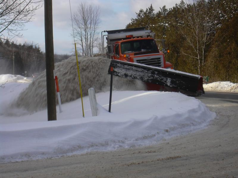 A Leelanau County Road Commission snowplow clears the roads after a heavy snow.