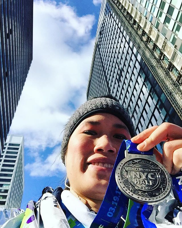 """That random """"I've just finished, here's my medal, some skyscrapers, & you can see up my nose"""" pic. United NYC Half Marathon 2017.  #finisher #unitednychalf #halfmarathon #nyrr #run #runner #instarunner #running #thingsiseewhilerunning #nyc #medal #winter #financialdistrict"""