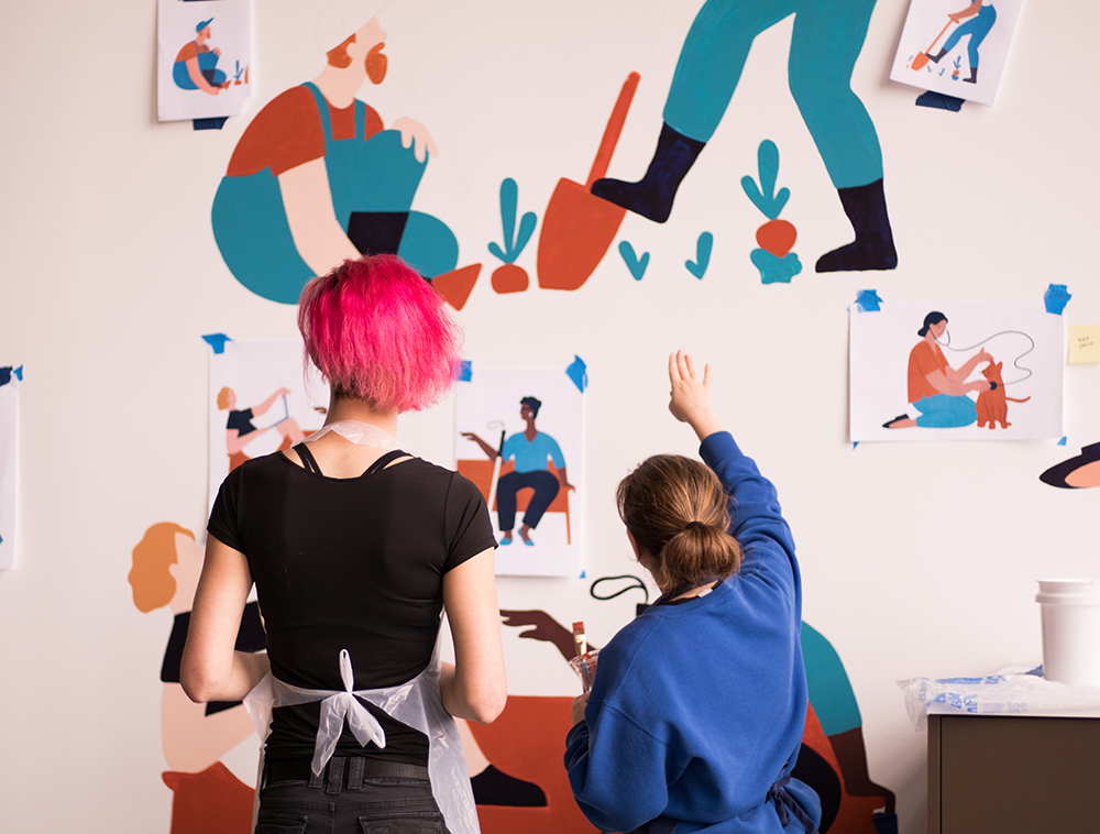 We created a paint-by-numbers collaborative mural showcasing our customers. All Gusto employees were invited to help paint the mural during our first week in the office. The mural was illustrated by my talented teammate,  Camellia Neri .